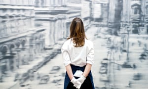 A Sotheby's employee in front of one of Gerard Richter's photo-realist images.  The work will go on sale at Sotheby's New York in May.