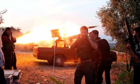 Free Syrian Army fighters fire a rocket at a castle in Harem town, Idlib governorate