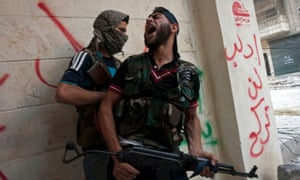 Free Syrian Army fighters take cover as they exchange fire