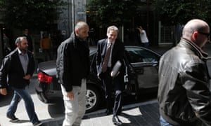 Heavily protected: Poul Thomsen, deputy director of the IMF's European department and mission chief for Greece, arrives at the Finance Ministry for a meeting in Athens.