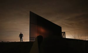 U.S. Border Patrol agent Sal De Leon stands near a section of the U.S.- Mexico border fence while stopping on patrol in La Joya, Texas. According to the Border Patrol, undocumented immigrant crossings have increased more than 50 percent in Texas' Rio Grande Valley sector in the last year.