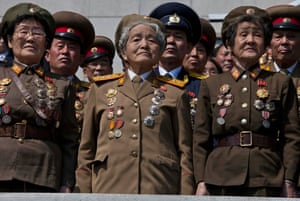 Retired North Korean military members stand at attention during an induction ceremony for children into the Korean Children's Union, the first political organization for North Koreans, held at a stadium in Pyongyang.