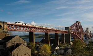 An East Coast train crosses the Forth rail bridge