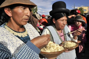 Aymara indigenous women taste food made with quinoa, in Challapata, southern Bolivia. The Bolivian government promotes the 'quinoa road', a network of roads where 48,500 tons of the cereal are planted each year. The goal is to reach one million tons of quinoa, worth one billion dollars, per year in the next ten years. Bolivia produces 70% of the world's quinoa.