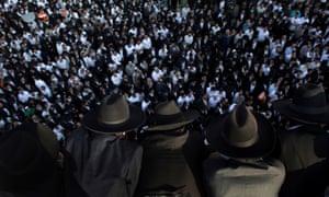 Ultra-orthodox Jewish gather on a rooftop the funeral of Rabbi Yaakov Yosef, son of Rabbi Ovadia Yosef, in Jerusalem.
