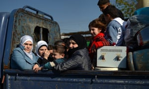 Civilians flee the northern Syrian city of Aleppo. A major coalition of Islamist rebels fighting the regime of President Bashar al-Assad has denounced Al-Nusra Front's pledge of allegiance to Al-Qaeda, urging insurgents to unite behind moderate Islam.