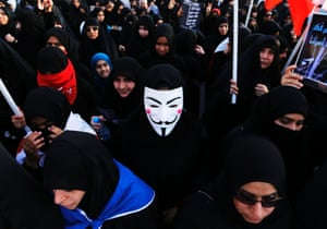 A female protester wearing a Guy Fawkes mask participates in an anti-government rally organised by Bahrain's main opposition group Al Wefaq, in the village of Salmabad south of Manama.