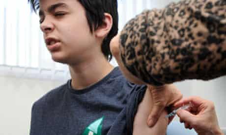 An MMR jab is given to Kieran Elford, 13, in Swansea, south Wales