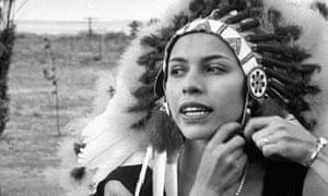 Maria Tallchief donning a headdress in 1953