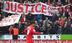Liverpool fans hold up banners calling for justice for the Hillsborough victims