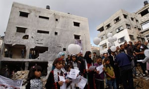 Balloons are released outside the destroyed house of the Dalou family in Gaza City