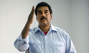 Nicolas Maduro gestures as he casts his vote in an election that has made him president