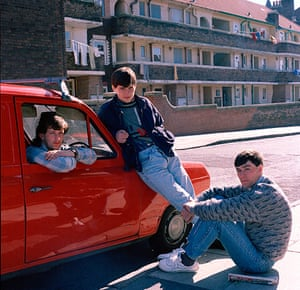 Big Picture - Rob Bremner: three young boys sitting and standing next to red van