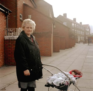 Big Picture - Rob Bremner: woman standing next to a pushchair in bleak housing estate