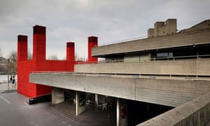 The Shed nestles in the embrace of the National Theatre's concrete flanks.