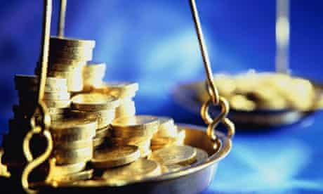 coins on a weighing scale