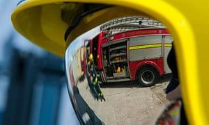 Fireman in helmet with reflective visor down