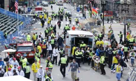 Medical workers aid injured people at the finish line of the 2013 Boston Marathon following an explosion.