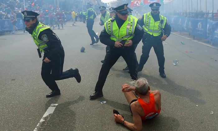 Boston Marathon blasts: three dead and more than 100 injured – as it