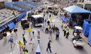 Police clear the area at the finish line of the 2013 Boston Marathon following at least one explosion.