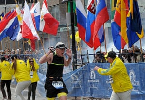 Boston explosions update: A runner and race officials react to an explosion during the Boston Marathon
