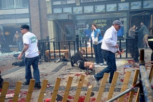 Boston explosions update: Injured people and debris lie on the sidewalk near the finish line