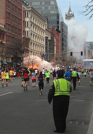 Boston explosions update: Runners continue to run towards the finish line as an explosion takes place