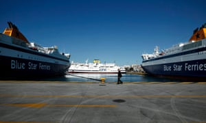 A man walks past moored ships at the port of Piraeus, Greece, 16 April 2013. A 24-hour strike was called by all Greek seamen unions against the vote of a bill undermining their collective bargaining rights and to protest austerity measures on 16 April.