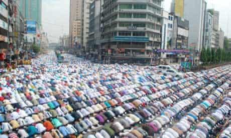 Muslim men pray in the street in Dhaka