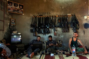 Pulitzer prize: Free Syrian Army fighters sit in a house on the outskirts of Aleppo