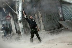 Pulitzer prize: A rebel fighter gestures after firing a shoulder-fired missile