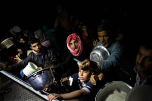Pulitzer prize: Displaced Syrian men wait for food near an NGO charity kitchen