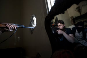 Pulitzer prize: A rebel sniper aims at a Syrian army position
