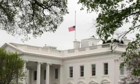 The American flag is lowered at the White House to mark those who died in the Boston Marathon bombings.