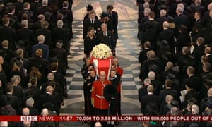 Lady Thatcher's coffin being carried out of St Paul's Cathedral.