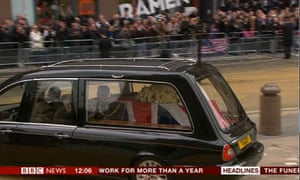 Lady Thatcher's coffin is driven away from St Paul's in a hearse.