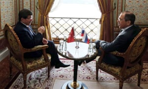 Russian Foreign Minister Sergei Lavrov speaks with his Turkish counterpart Ahmet Davutoglu before talks on the Syria crisis in Istanbul.