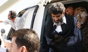 Abdullah al-Senussi, Gaddafi's former intelligence chief, arriving at the high security prison facility in Tripoli, in September 2012 after being extradited from Mauritania.