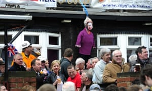 An effigy of Baroness Thatcher hangs near the Goldthorpe Union Jack Memorial club as local residents celebrate her death on the day of her funeral at St Paul's Cathedral.