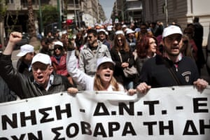 "Hospital workers carry a banner reading ""government, IMF, EU-troika are harmful for the public health"" on April 17, 2013 outside the ministry of health in Athens.  Athens has pledged to cut 4,000 state sector jobs this year and 11,000 in 2014 to unlock access to 8.8 billion euros ($11.5 billion) in EU-IMF loans next month."