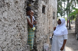 Mwatima Khamis, a nurse in eastern Zanzibar, conducts an outreach visit