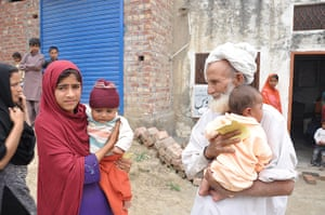 Three generations of a family turn up for a vaccination session in the village of Chinkowindi, Pakistan