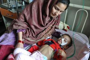 Two-year-old Falak Naz recovering from pneumonia in hospital with her mother