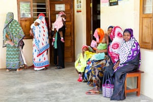 Mothers wait at a health clinic in Zanzibar for their children to receive vaccines