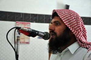 Local Imam Qari Saifullah calls villagers to bring their babies for immunisation