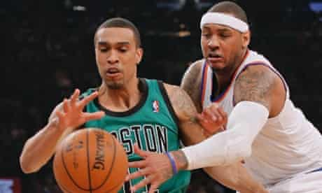 New York Knicks forward Carmelo Anthony tries to steal the ball from Boston Celtics guard Courtney Lee (L) in the first quarter of their NBA basketball game at Madison Square Garden in New York, March 31, 2013. REUTERS/Ray Stubblebine (UNITED STATES - Tags: SPORT BASKETBALL) :rel:d:bm:GF2E94102M401