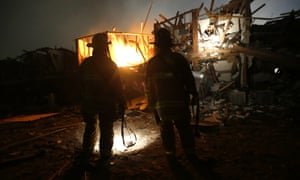 Firefighters earch a destroyed apartment complex near a fertilizer plant in West, Texas.