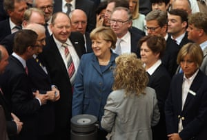 German Chancellor Angela Merkel chats with colleagues prior to voting on EU finanical aid to Cyprus at the Bundestag on April 18, 2013 in Berlin, Germany