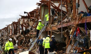 Firefighters conduct a search and rescue operation at an apartment destroyed by an explosion at a fertilizer plant in West, Texas.