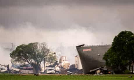 The remains of the the West Fertilizer Co plant in West, Texas smolder in the rain.
